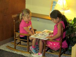 2 Children's House students reading together
