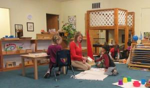 Children's House teacher working with students
