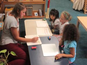 Teacher working with group of 3 students