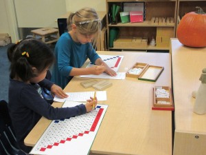 Children's House students working together