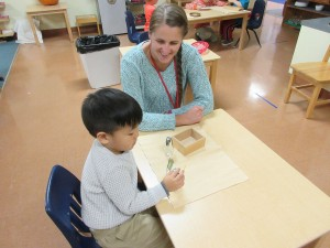 Children's House teacher and student working together