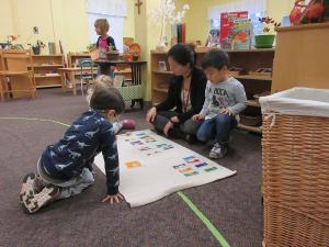 Teacher working with Children's House students