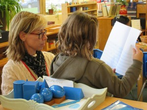 Elementary teacher working with student