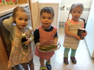 Three young children as chefs in the kitchen