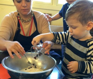 Teacher cooking with young children