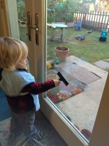 Young children washing a window
